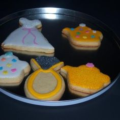 These are the cookies I baked. We did not have time in one day to learn the decorating part so Christine Brower graciously offered to decorate and deliver them to me in time for my Networking Event for Wedding Professionals where my wedding dress cookies,engagement ring cookies and teapot cookies were enjoyed by all!