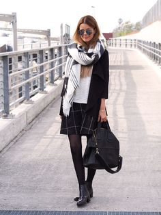 Annette Haga is wearing a big grid print skirt from Weekday