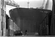 """A kid on a chopper playing in the shadow of the supertanker Tyne Pride at Swan Hunter shipyard, Wallsend, Tyneside Photo Tom Buist"" Old Pictures, Old Photos, Blaydon Races, The Great, North Shields, The Last Ship, Merchant Navy, North East England, Dundee"