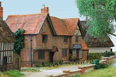 Our Image Gallery | Pendon Museum | Modelling the past for the future. Duck's Stores: a building of status and great antiquity with crooked timber framing, herringbone brickwork and tiled roof, it was perhaps the house of a yeoman farmer but is now the village general store. (Image: Stephen Williams).