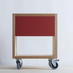 Birch plywood bedside cabinet with soft close drawer, coloured front on lockable castors