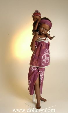 """Dolls by Bets & Amy Van Boxel/Damba is 31""""   and 34""""   when baby Baba is on her shoulders."""