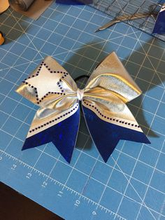 Blue silver white rhinestone cheer bow...can be done by BowingItUp
