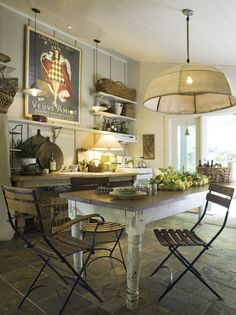 I love everything about this kitchen but wish they had put that blue stone (a type of slate) on the floor.