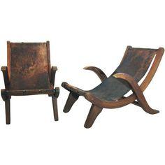 "Clara Porset ""Miguelito"" lounge chairs:"