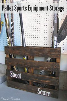 Sports Equipment Storage Turn an old pallet into sports equipment storage! Pefect for hockey sticks, baseball bats, etc. // Turn an old pallet into sports equipment storage! Pefect for hockey sticks, baseball bats, etc. Sports Organization, Garage Organization, Garage Storage, Workshop Organization, Organization Ideas, Organized Garage, Garage Shelving, Old Pallets, Recycled Pallets