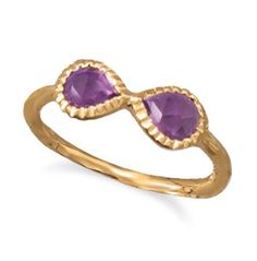 Beautiful gold ring with precious stone in and infinity design.  Express your infinite love for any lady in your life.