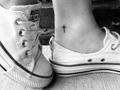Small cross ankle tattoo