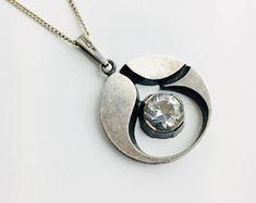 A big Modernist Karl Laine sterling silver and Rock Crystal pendant, Sten & Laine, 1974, Made in Finland