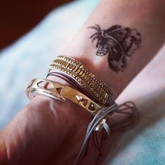 LOVE this!!! and positioning is so nice.@Penny Douglas People   bracelets and a butterfly temporary tattoo #freepeople #tattoo