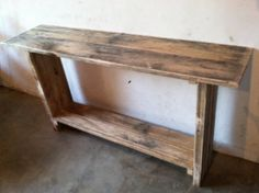 This handcrafted entryway table is perfect for displays of any kind, with a lower shelf to put your shoes or boots away off the floor. The rustic