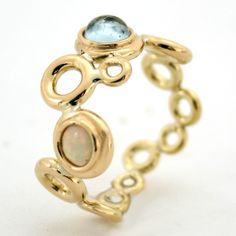 Ocean Foam ring with Aqua & Opal in 18 ct gold by Serena Fox: http://www.fldesignerguides.co.uk/engagement-ring-designer/serena-fox