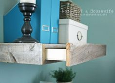 DIY Floating shelves with a secret drawer inside! Love that they're made from reclaimed wood. {Not Just a Housewife}