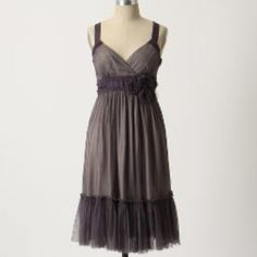 Anthropologie Moulinette Soeurs rosette dress This Anthro Moulinette Soeurs is amazing! It features a beautiful eggplant nylon betting overlay with grey lining with lace trim, netting rosettes, zip up the side and in gorgeous condition. Anthropologie Dresses