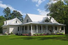 Traditional southern country style house with generous wrap-around porch and modern floor plan.  Plan 137-252.