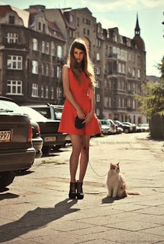 Cute red dress... But why is that cat on a leash..?