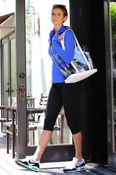 Though Stacy Keibler isn't showing much skin while leaving the gym, her colorful gym look is still sassy! And we love it!