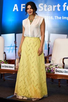 5 July 2016 - Priyanka Chopra teamed a white sleeveless shirt with a yellow maxi skirt for a Unicef event in New Delhi.   - HarpersBAZAAR.co.uk