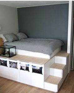 If you want extra storage, a raised bed is the way to go. Nine sturdy IKEA kitchen cabinets hold personal items. hacks bedroom bed 15 Beds Made Much Cooler with IKEA Hacks Double Bed With Storage, Platform Bed With Storage, Bed Frame With Storage, Platform Beds, Extra Storage, Raised Platform Bed, Diy Double Bed, Small Double Bedroom, Ikea Beds With Storage
