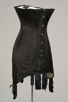 Circa 1910 Corset, American. Black silk with steel boning. Gift of Warnaco, Inc. via KSUM.