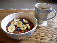 Healthy chocolate porridge with banana and blueberries.