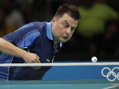 Aleksandar Karakasevic (SRB) returns the ball against Paul Drinkhall (GBR) during round 1 of a table tennis match at Riocentro Pavilion 3 in the Rio 2016 Summer Olympic Games.  Andrew P. Scott-USA TODAY Sports