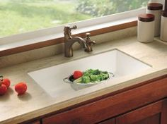 The Most Versatile Sink  Solid surface can be ordered with an integral sink, so there are no seams to clean. Its warm matte finish resists heat, and can be sanded if it gets scratched. The acrylic polymer material comes in dozens of colors, including ones that mimic the look of stone, such as Carrara marble and lapis lazuli. Shown: Buried Beach by Corian