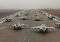 F-16 Fighting Falcons from Fighter Squadrons of the 8th Fighter Wing, the 388th Expeditionary Fighter Wing and the 38th Fighter Group of the ROK Air Force demonstrate an 'Elephant Walk' as they taxi d