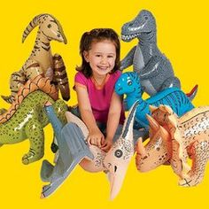Dinosaur Birthday Party Favor Ideas for Girls: inflatable dinos, dino dig container, book