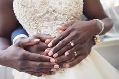 Sweet Couple Touch Hands | Photography: Carasco Photography. Read More:  http://www.insideweddings.com/weddings/church-ceremony-with-nigerian-traditions-chic-ballroom-reception/845/