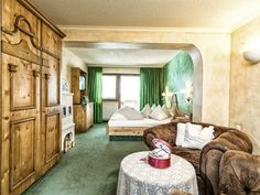 Bergland Junier Suite im Wellnesshotel Bergland in Hintertux. #familiensuite #suite #komfort #gletscherblick #wellnessurlaub #skiurluab #wanderulraub #familienurlaub #kachelofen #gesund_schlafen