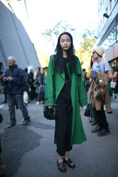 Outside the Paris shows.  Emerald green over all black + understated shoes and accessories.