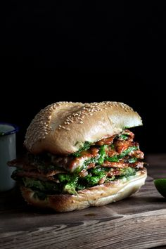 STACKED GREEN PIG SANDWICH - paper thin pork cutlets with arugula and anchovy green sauce, avocado and sesame rolls.