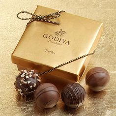 "Godiva Chocolatier is a manufacturer of premium chocolates and related products. Godiva, founded in Belgium in 1926, was purchased by Turkish Yıldız Holding, owner of the Ülker Group, on November 20, 2007.In addition to chocolates, Godiva also sells truffles, coffee, cocoa, biscuits, dipped fruits and sweets, chocolate liqueur, shakes,wedding and party favors and other items arranged in gift baskets.Godiva's signature package is the Gold Ballotin (French for ""small, elegant box of…"