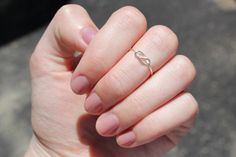 Knuckle Ring : Tiny Delicate Silver Plated Wire Infinity Knot Ring, First Knuckle Ring, Hand Bent, Friendship, Promise, Wish, Reminder. $11.50, via Etsy.