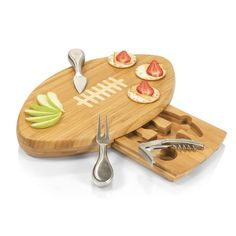 "The Quarterback cutting board and tool set is a 15"" x 8.75"" x 1.5"" board made of eco-friendly bamboo with a professional football design. With 95 square inches of cutting surface, it can be used as a cheese board or serving tray and comes with three hollow-handled brushed stainless steel tools including one pointed-tip hard cheese knife, one cheese knife, and one waiter-style corkscrew. Let the Quarterback help call the shots at your next game-watching party."
