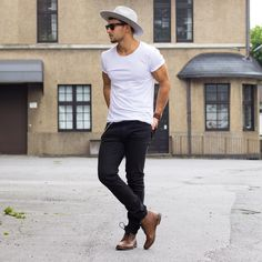 Casual street style look. White shirt ,jeans, and boots amaze balls