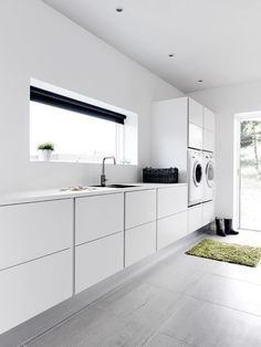 Laundry rooms are notorious for being cramped. If you need new inspiration for making over your laundry room, these laundry room ideas will help you save precious space and time. Just because you have a tiny laundry room, that doesn't… Continue Reading → Laundry Room Tile, Modern Laundry Rooms, Laundry Room Cabinets, Laundry Room Organization, Organization Ideas, Storage Ideas, Laundry Storage, Küchen Design, House Design