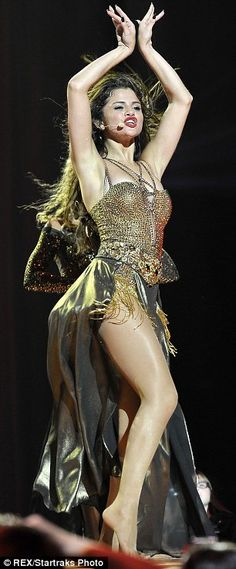 Going for gold: Selena Gomez showed her sexy side on Wednesday as she kicked off her Stars Dance tour