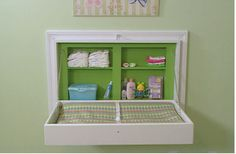 A fold up changing table! This is so cool, however, I suck at stuff like that. But talk about an awesome space saver!