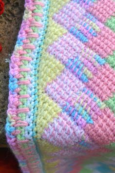 Close-up of how I finished My first Tunisian Enterlac baby blanket. Spring 2014