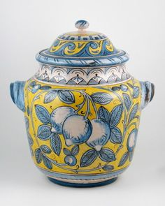 Sculptural inspiration (handle) and painted inspiration (pattern and color); fruit patterning could be for a pot or bowl