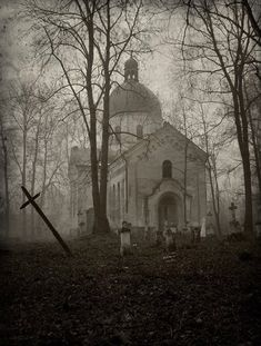 Abandoned cemetery and church. Looks like a scene from a scary movie.