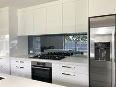 Escape Glass Invercargill New Zealand White Contemporary Kitchen, Modern Grey Kitchen, Contemporary Kitchen Cabinets, Modern Kitchen Design, Kitchen Mirror Splashback, Backsplash For White Cabinets, Glass Splashbacks, Kitchen Pantry Design, Kitchen Decor