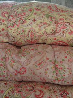vintage paisley eiderdowns - my favourite at the cottage