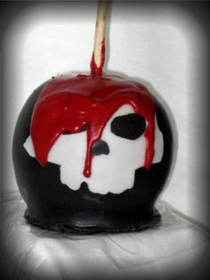 The Poisoned Apples' signature Caramel Apple, dipped in black chocolate with a white fondant skull and red chocolate blood. Perfect for a Halloween party!