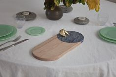 The table's permanent vignette includes a Bower serving tray and cheese board — in hard to find blue marble — and vintage jadeite plates — all available in the shop.