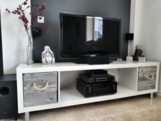 Using a Ikea Expedit as tv stand, but making it more fun by adding self made boxes made from pallet wood. Drilled a hole in the box and add...