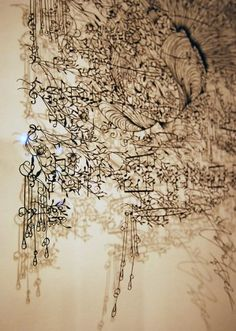""""""" Aoyama, born in Yokohama, Japan, now resides in Ferney Volaire, (Western) France. She creates these incredibly detailed and intricate lace like kirie (paper cutout) art work with a """"simple pair of scissors."""""""
