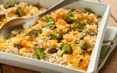Broccoli, Rice and Cheese  These are my modifications: - No butter - Cooked onion and garlic + rice to brown slightly (think rice pilaf prep). - Heated up 1/4 cup of sun dried tomatoes packed in oil in a pan. Once the oil is hot I added the broccoli + mushrooms - In a pot, I heated the soup then whisked in 2TBS of flour, 1 tsp of cayenne, salt, pepper, and all the cheese. I   let it thicken slightly and then whisked in 1 beaten egg. Then I added the veggies and rice into the pot.